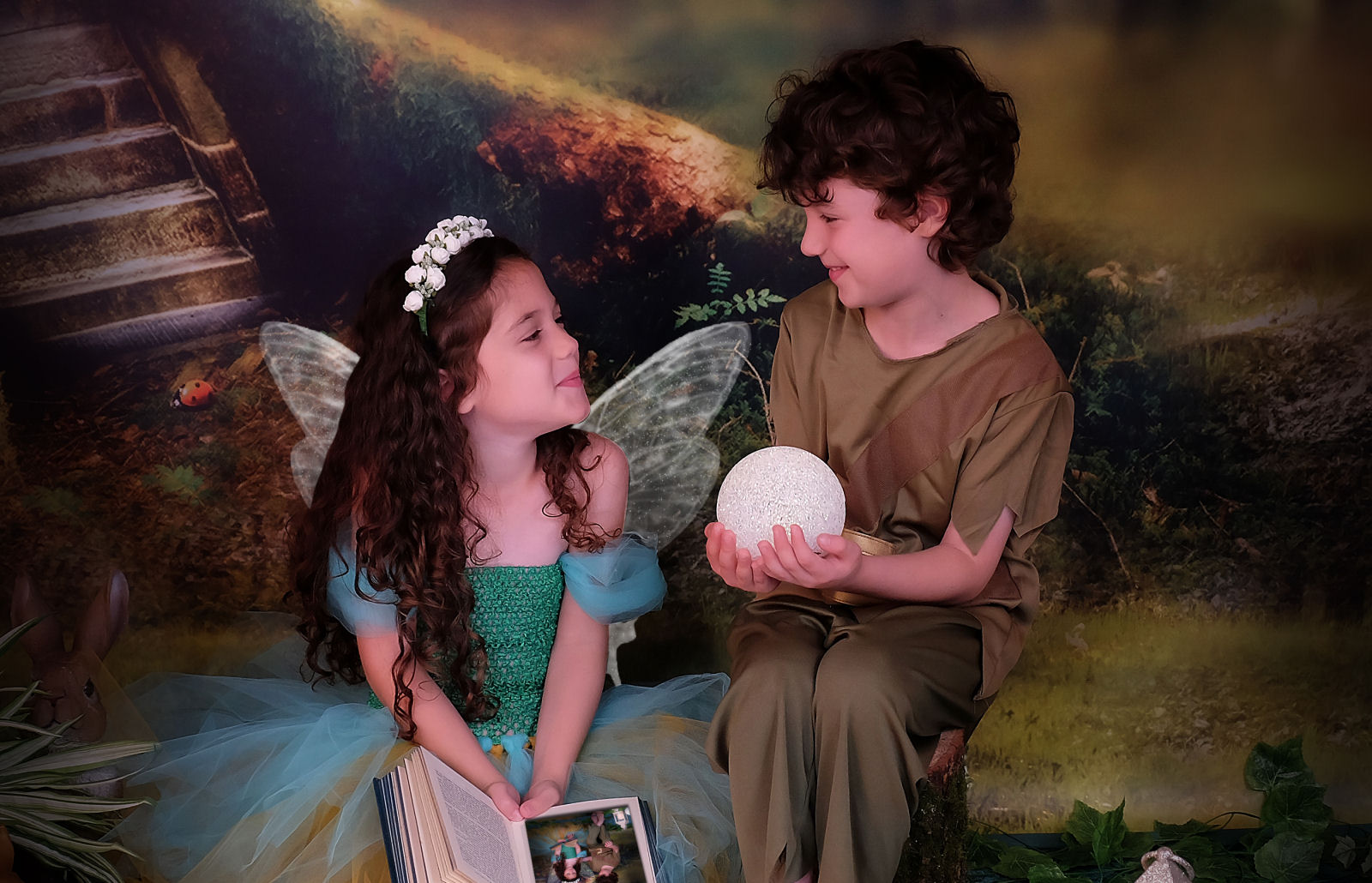 Photo of boy and girl dressed up as a fairy and elf